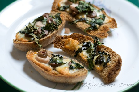bruschetta with olives, cheese, garlic, & basil