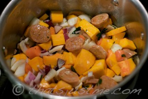 veggies and chorizo sausage ready to be cooked on stove
