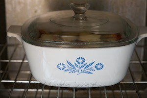 oven safe dish with cover, in the oven