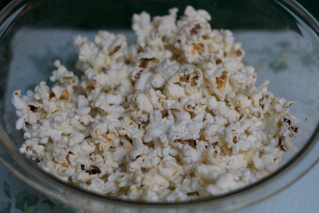 enjoy homemade microwave popcorn with olive oil