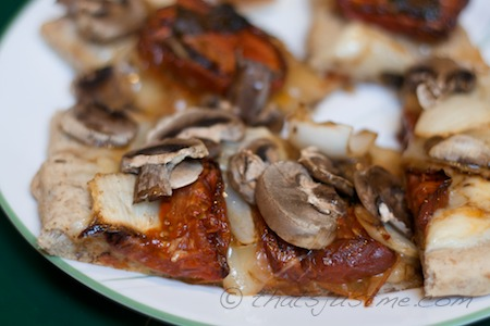 flatbread pizza with roasted tomatoes and onions