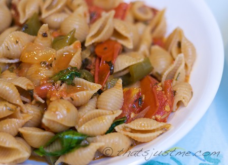 whole wheat pasta shells with roasted tomatoes, peppers and onions