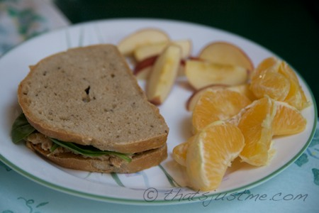 tuna spinach sandwich with a side of fruit