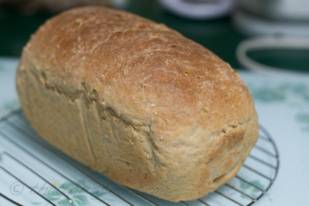 A loaf of whole wheat oatmeal bread