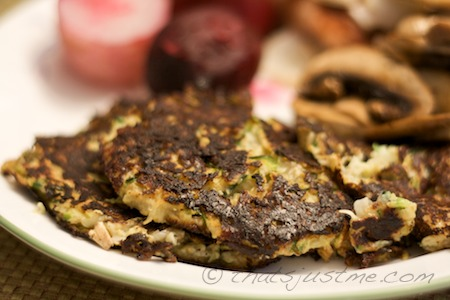 zucchini and onion pancakes served with pork chops, mushrooms, and beets