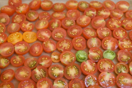 sliced cherry tomatoes before oven drying